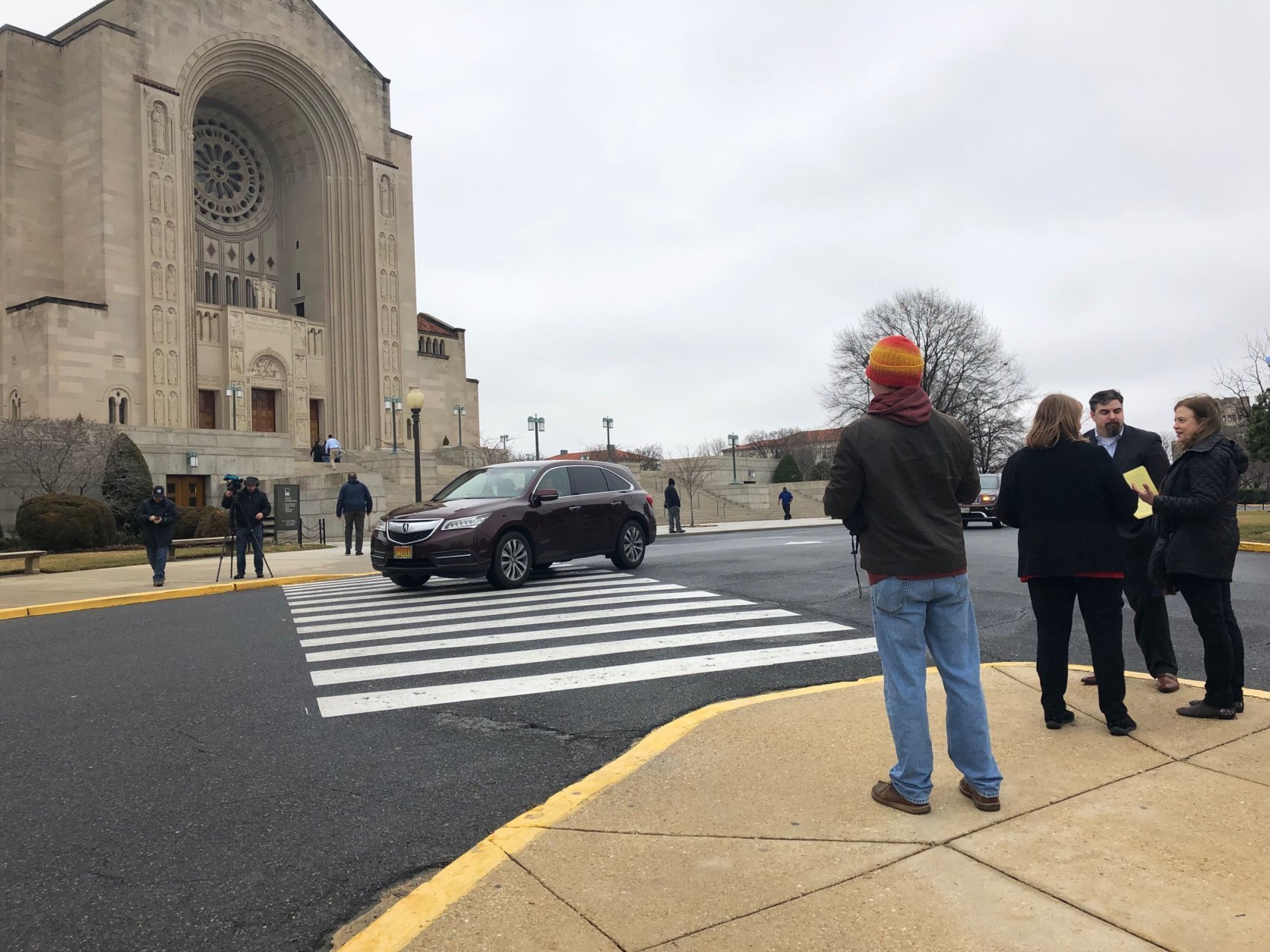Members of SNAP hand out fliers on how to help survivors of sex abuse at the Basilica of the National Shrine of the Immaculate Conception. (WTOP/Keara Dowd)