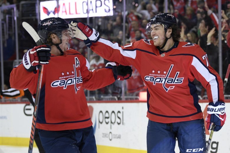 7d857873890 Washington Capitals right wing T.J. Oshie (77) celebrates his goal with  center Nicklas Backstrom (19)