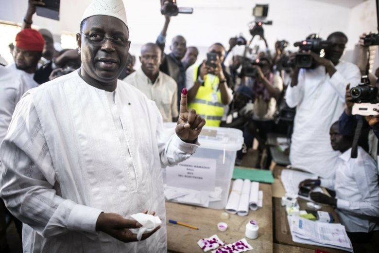b9213766d 24, 2019 file photo Senegal's incumbent President Macky Sall casts his vote  during the presidential election at a polling station.