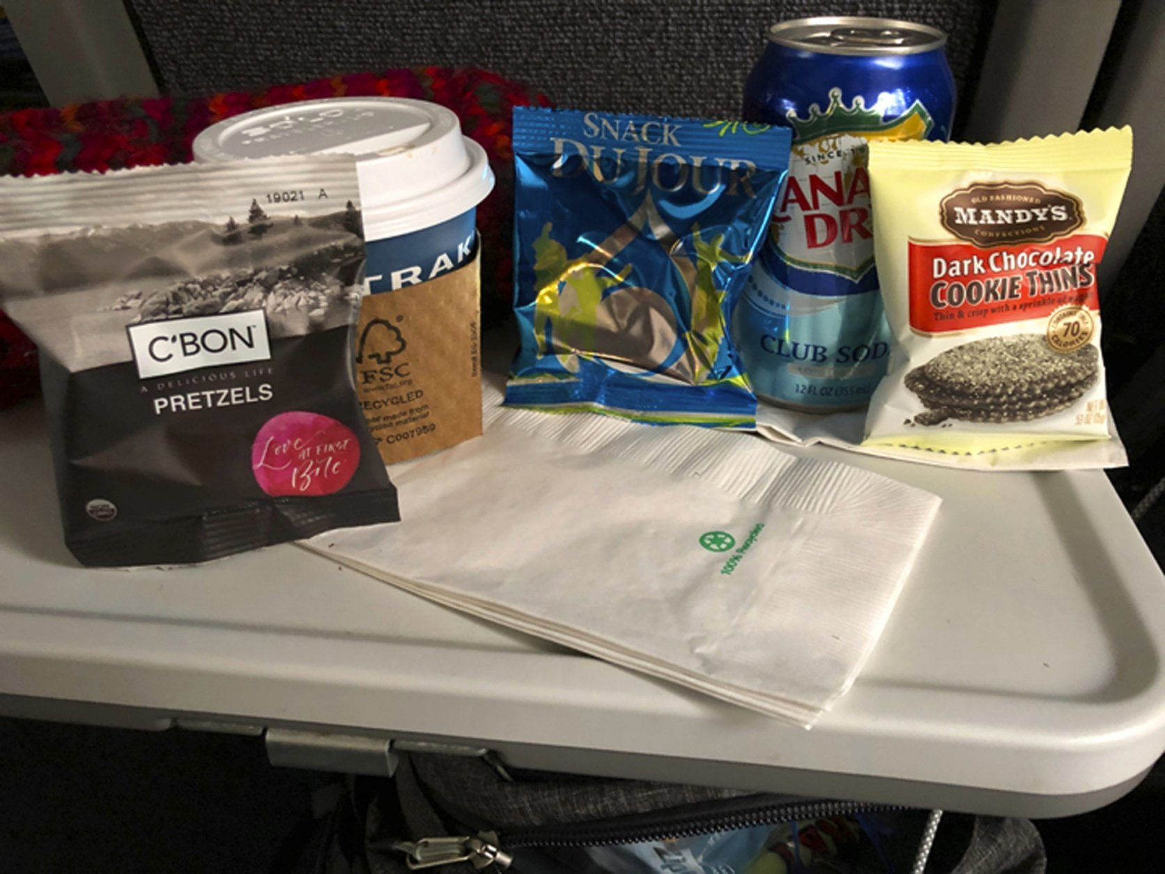 This photo provided by Emilie Wyrick shows some of her subsistence rations as she waited aboard a stranded Amtrak train after it hit downed trees during a blizzard in the Oregon mountains and stopped for a day and a half, seen early Tuesday, Feb. 26, 2019. During the 36 hours that the train was stuck, younger passengers helped older ones reach their families to let them know they were all right. The trouble began Sunday evening, when the double-decker Coast Starlight train struck a tree that had fallen onto the tracks, Amtrak said. (Emilie Wyrick via AP)