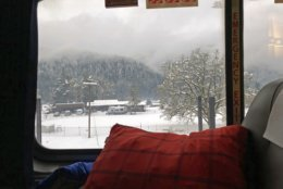 This photo provided by Emilie Wyrick shows the view from an Amtrak train after it hit downed trees during a blizzard in the Oregon mountains and got stranded for a day and a half, seen early Tuesday, Feb. 26, 2019. During the 36 hours that the train was stuck, younger passengers helped older ones reach their families to let them know they were all right. The trouble began Sunday evening, when the double-decker Coast Starlight train struck a tree that had fallen onto the tracks, Amtrak said. (Emilie Wyrick via AP)