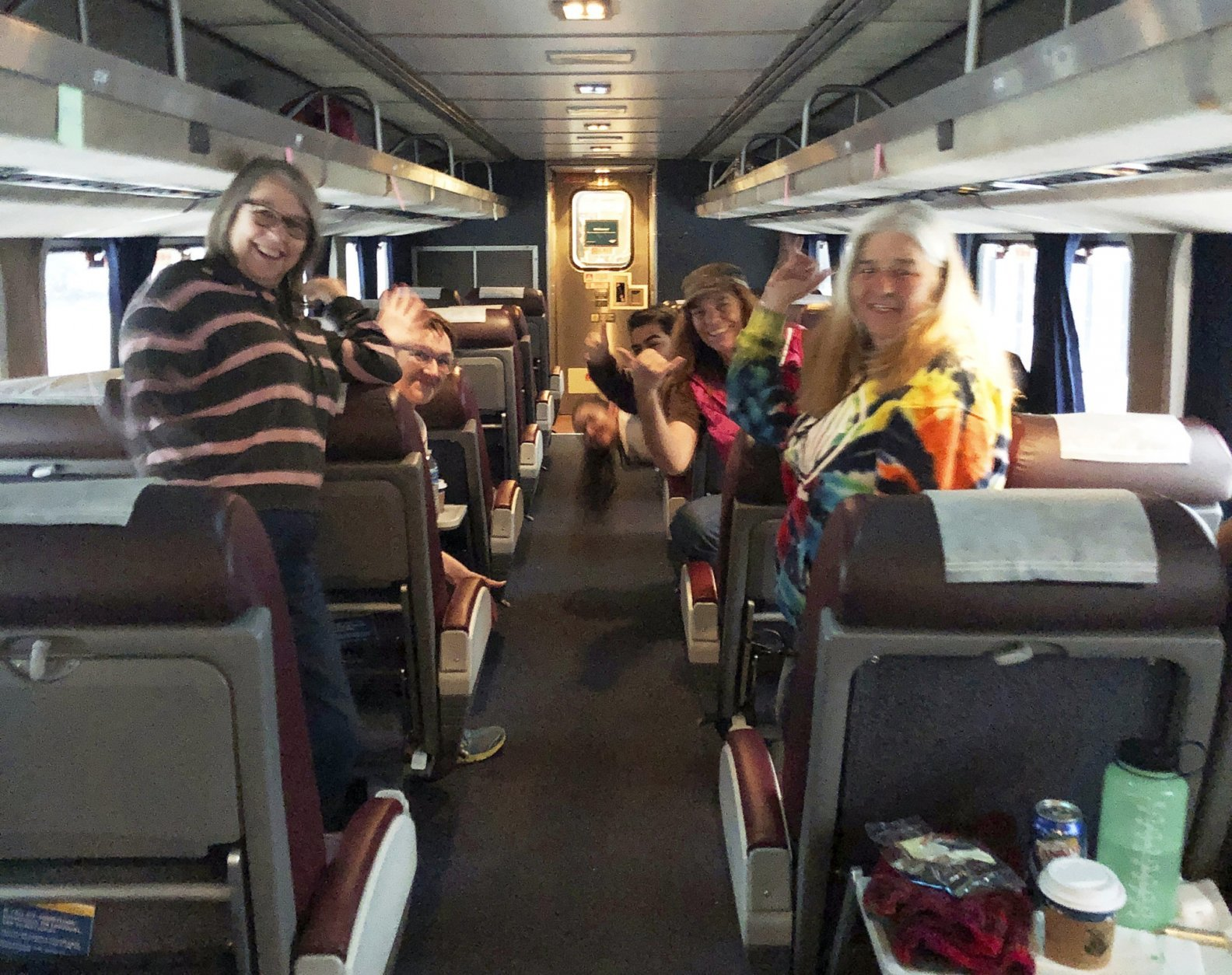 This photo provided by Emilie Wyrick shows passengers aboard a stranded Amtrak train making the best of their situation after the train hit downed trees during a blizzard in the Oregon mountains and was stopped for a day and a half, seen early Tuesday, Feb. 26, 2019. During the 36 hours that the train was stuck, younger passengers helped older ones reach their families to let them know they were all right. The trouble began Sunday evening, when the double-decker Coast Starlight train struck a tree that had fallen onto the tracks, Amtrak said. (Emilie Wyrick via AP)
