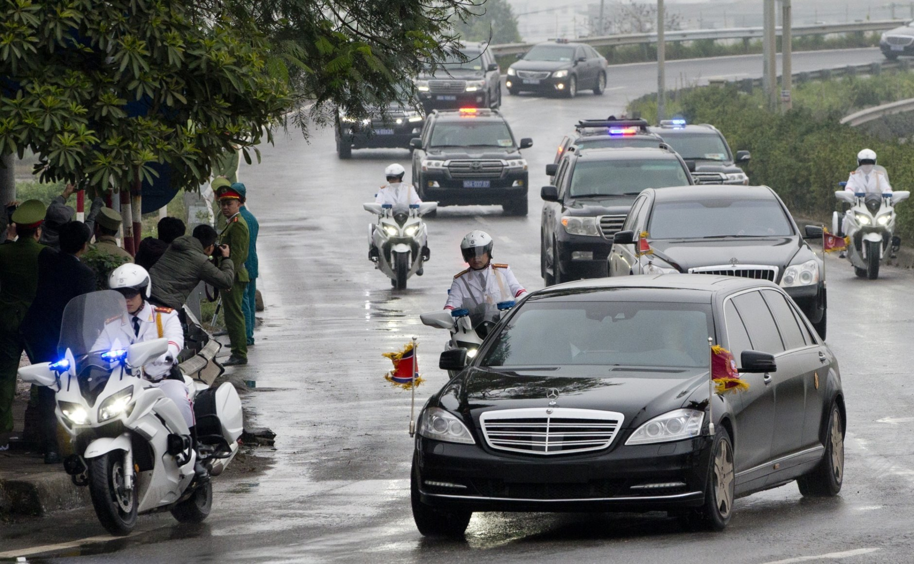 A motorcade carrying North Korean leader Kim Jong Un is driven to Hanoi, Vietnam, Tuesday, Feb. 26, 2019. Kim Jong Un has arrived in Vietnam for the North Korean leader's second summit with Donald Trump. (AP Photo/Gemunu Amarasinghe)