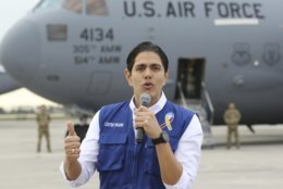 Lester Toledo from the Coalition Aid and Freedom Venezuela speaks in front of a C-17 cargo plane loaded with humanitarian commodities at Homestead Air Reserve Base Saturday, Feb. 16, 2019, in Homestead, Fla. The United States is airlifting and pre-positioning additional humanitarian commodities to provide relief to tens of thousands of Venezuelans suffering from severe food and medicine shortages. (AP Photo/Luis M. Alvarez)