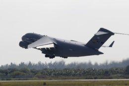 A C-17 cargo plane loaded with humanitarian commodities takes off from Homestead Air Reserve Base in route to Venezuela, Saturday, Feb. 16, 2019, in Homestead, Fla. The United States is airlifting and pre-positioning additional humanitarian commodities to provide relief to tens of thousands of Venezuelans suffering from severe food and medicine shortages. (AP Photo/Luis M. Alvarez)