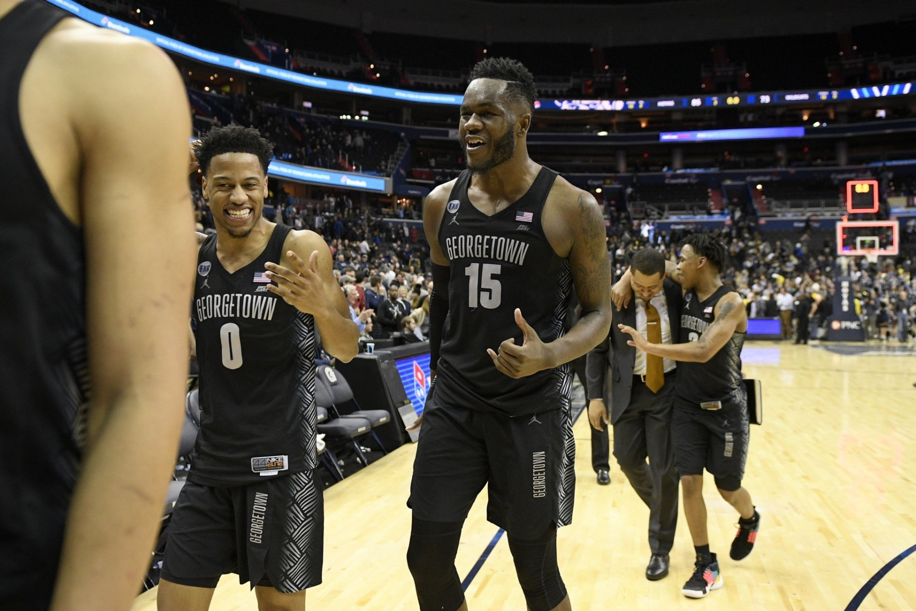 Georgetown guard Jahvon Blair (0), center Jessie Govan (15) and guard James Akinjo (3) react as they leave the court after an NCAA college basketball game against Villanova, Wednesday, Feb. 20, 2019, in Washington. Georgetown won 85-73. (AP Photo/Nick Wass)