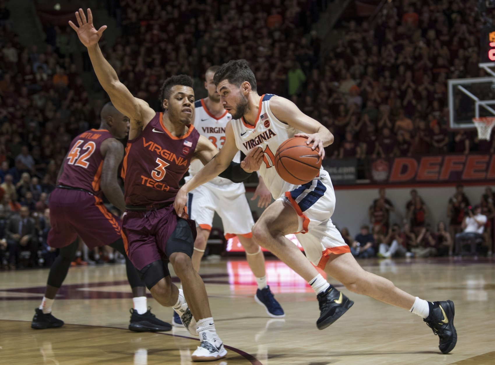 Virginia guard Ty Jerome (11) dribbles past Virginia Tech defender Wabissa Bede (3) during the first half of an NCAA college basketball game in Blacksburg, Va., Monday, Feb. 18, 2019.(AP Photo/Lee Luther Jr.)
