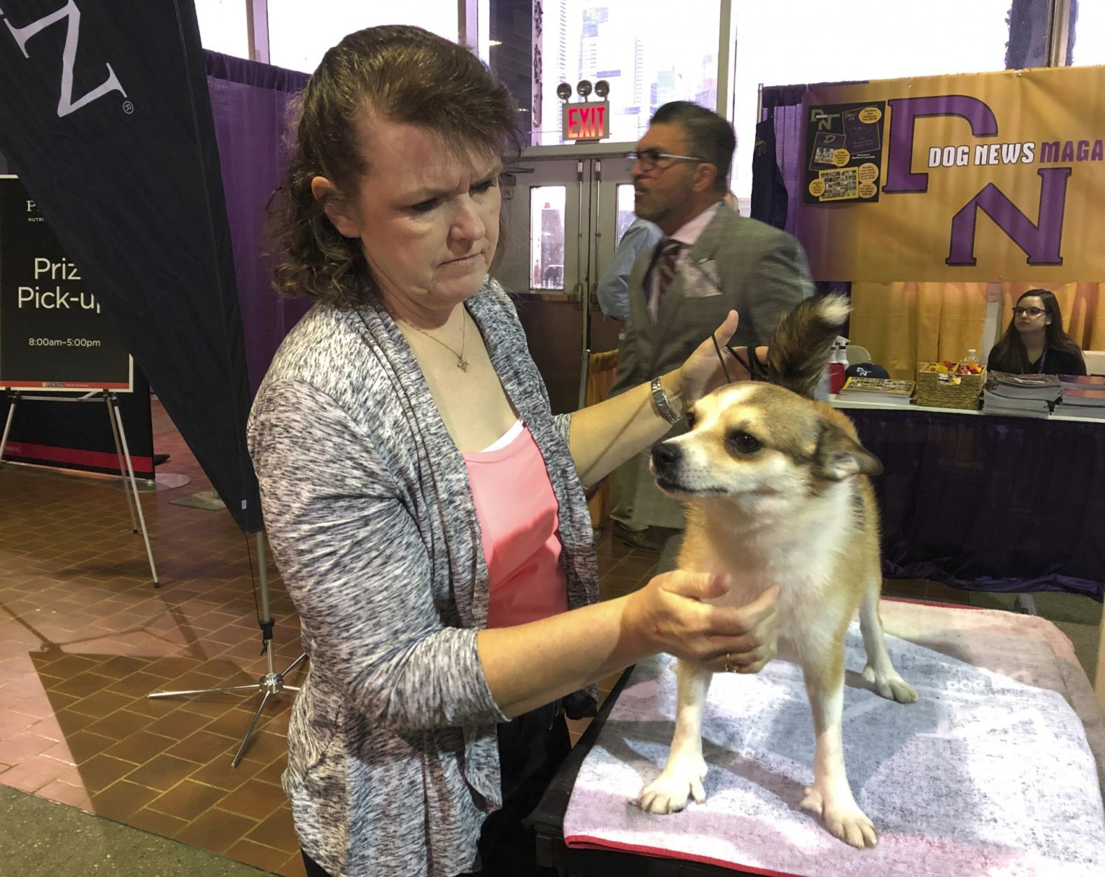 Tracy Rousseau of Franktown, Colo., pets Eva, a Norwegian lundehund, as they wait to compete at the Westminster Kennel Club dog show in New York on Monday, Feb. 11, 2019. (AP Photo/Jennifer Peltz)