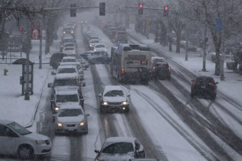 Record number of holiday travelers set to brave the roads and skies