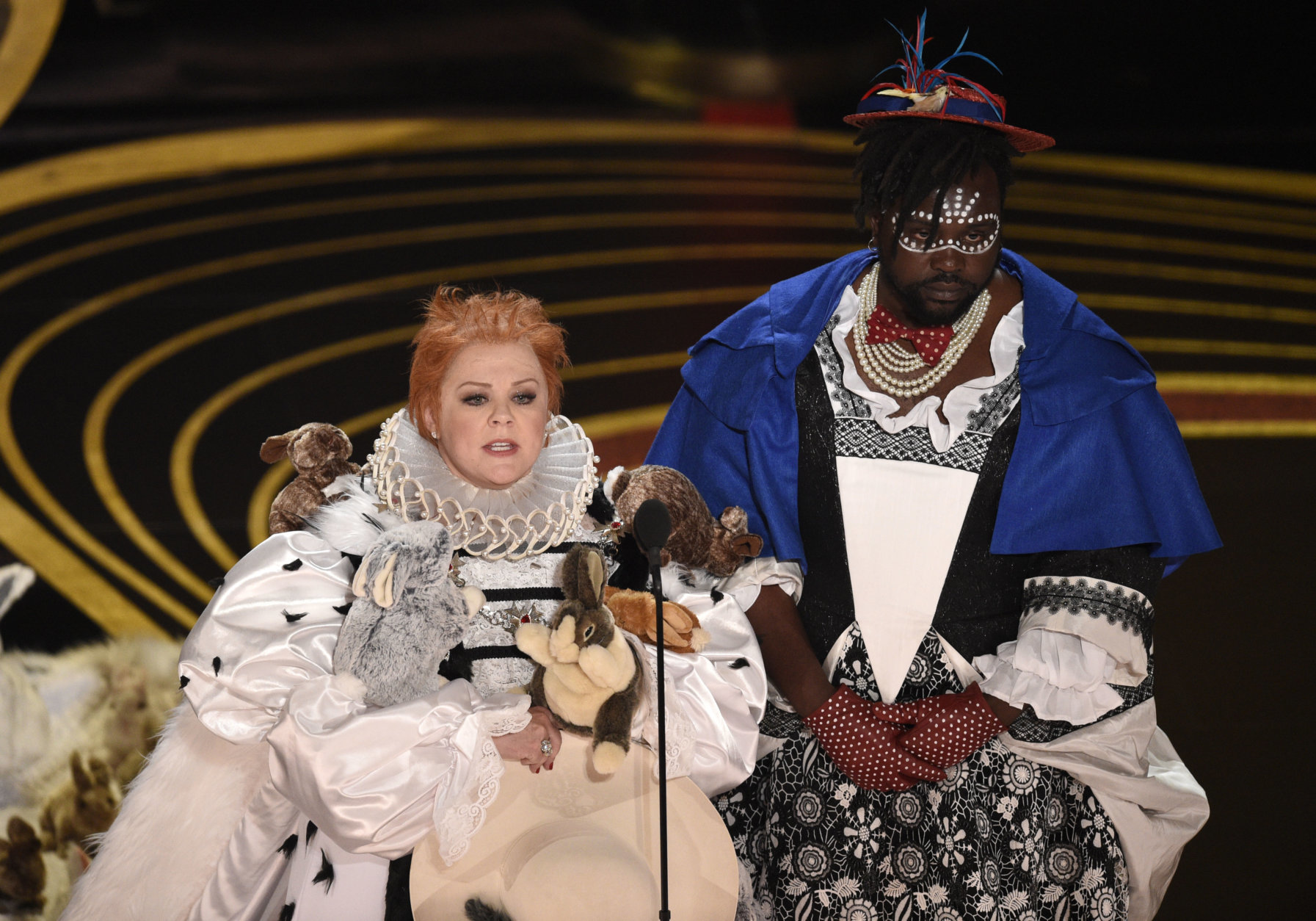 Melissa McCarthy, left, and Brian Tyree Henry present the award for best costume design at the Oscars on Sunday, Feb. 24, 2019, at the Dolby Theatre in Los Angeles. (Photo by Chris Pizzello/Invision/AP)