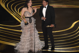 """Elizabeth Chai Vasarhelyi, left, and Jimmy Chin accept the award for best documentary feature for """"Free Solo"""" at the Oscars on Sunday, Feb. 24, 2019, at the Dolby Theatre in Los Angeles. (Photo by Chris Pizzello/Invision/AP)"""