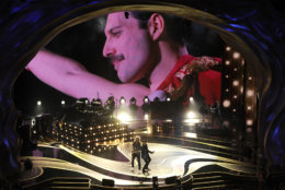 An image of Freddie Mercury appears on screen as Brian May, left, and Adam Lambert of Queen perform at the Oscars on Sunday, Feb. 24, 2019, at the Dolby Theatre in Los Angeles. (Photo by Chris Pizzello/Invision/AP)