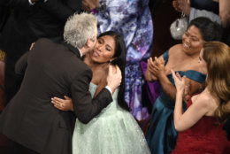 """Yalitza Aparicio, right, congratulates Alfonso Cuaron in the audience as he is announced the winner of the award for best cinematography for """"Roma"""" at the Oscars on Sunday, Feb. 24, 2019, at the Dolby Theatre in Los Angeles. (Photo by Chris Pizzello/Invision/AP)"""