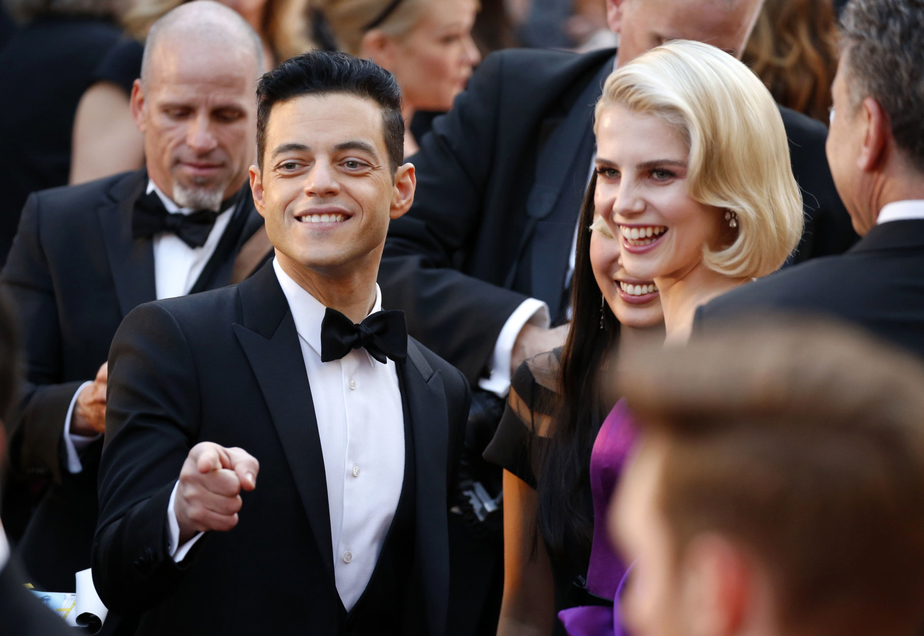 Rami Malek, left, and Lucy Boynton arrive at the Oscars on Sunday, Feb. 24, 2019, at the Dolby Theatre in Los Angeles. (Photo by Eric Jamison/Invision/AP)