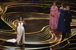 """Regina King accepts the award for best performance by an actress in a supporting role for """"If Beale Street Could Talk,"""" as Maya Rudolph, from second left, Tina Fey and Amy Poehler look on at the Oscars on Sunday, Feb. 24, 2019, at the Dolby Theatre in Los Angeles. (Photo by Chris Pizzello/Invision/AP)"""