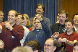 """Mars Exploration Rover mission members celebrate a successful egress of the rover """"Opportunity"""" at NASA's Jet Propulsion Laboratory in Pasadena Calif., Saturday, Jan. 31, 2004. Opportunity, NASA's second rver rolled 10 feet off its lander onto the surface of Mars. (AP Photo/Chris Carlson)"""
