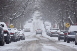 Snow covered the streets in Northwest D.C. early Friday afternoon. (WTOP/Dave Dildine)