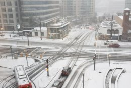 Tire tracks cut through the snow at this Friendship Heights intersection. (WTOP/Brandon Millman)