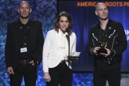 """Phil Hanseroth, from left, Brandi Carlile and Tim Hanseroth accept the award for best American roots performance for """"The Joke"""" at the 61st annual Grammy Awards on Sunday, Feb. 10, 2019, in Los Angeles. (Photo by Matt Sayles/Invision/AP)"""
