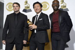 """Jason Cole, from left, Hiro Murai and Ibra Ake pose in the press room with the award for best music video for Childish Gambino's """"This Is America"""" at the 61st annual Grammy Awards at the Staples Center on Sunday, Feb. 10, 2019, in Los Angeles. (Photo by Chris Pizzello/Invision/AP)"""