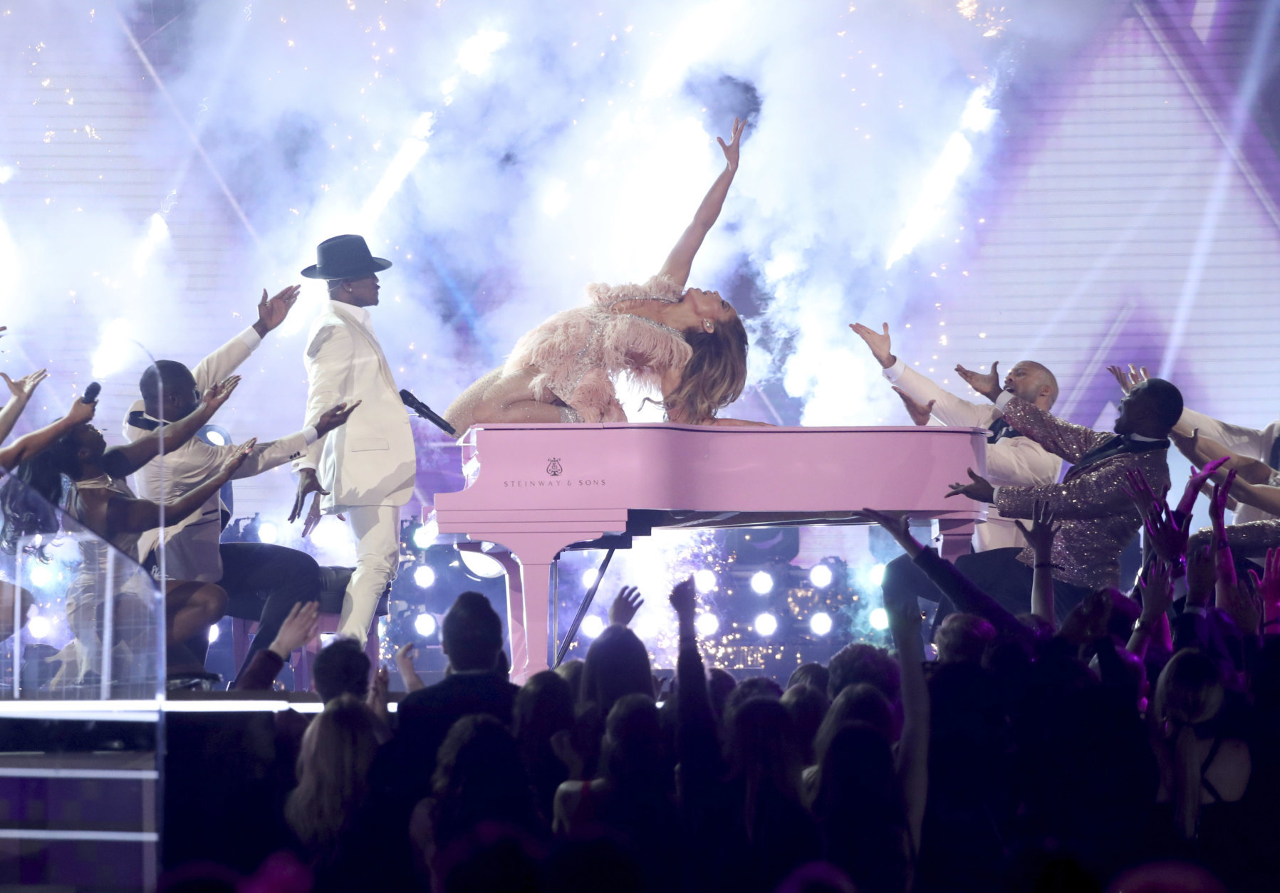 Ne-Yo, left, and Jennifer Lopez perform a medley during a tribute to Motown's 60th anniversary at the 61st annual Grammy Awards on Sunday, Feb. 10, 2019, in Los Angeles. (Photo by Matt Sayles/Invision/AP)