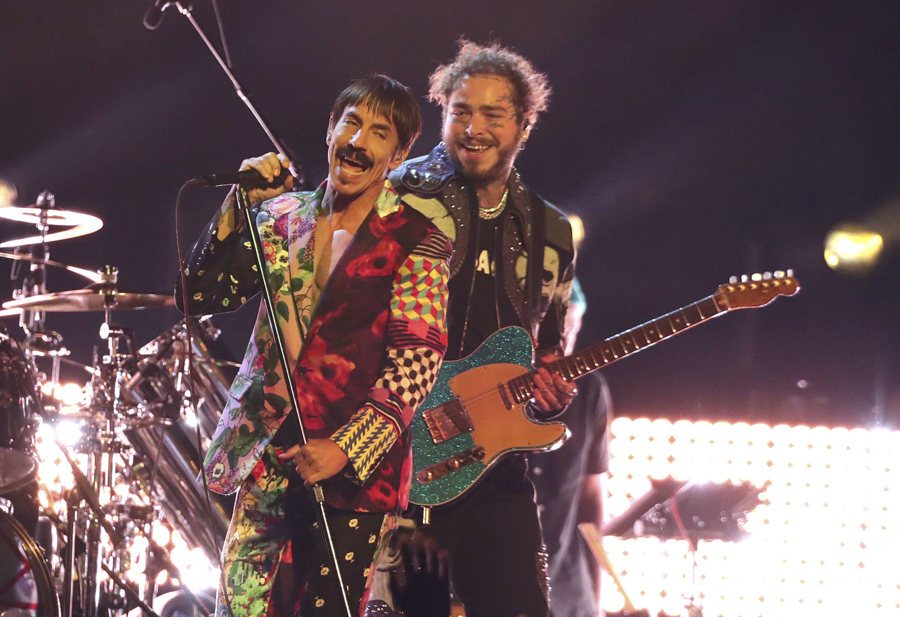 Anthony Kiedis, left, of Red Hot Chili Peppers, and Post Malone perform a medley at the 61st annual Grammy Awards on Sunday, Feb. 10, 2019, in Los Angeles. (Photo by Matt Sayles/Invision/AP)