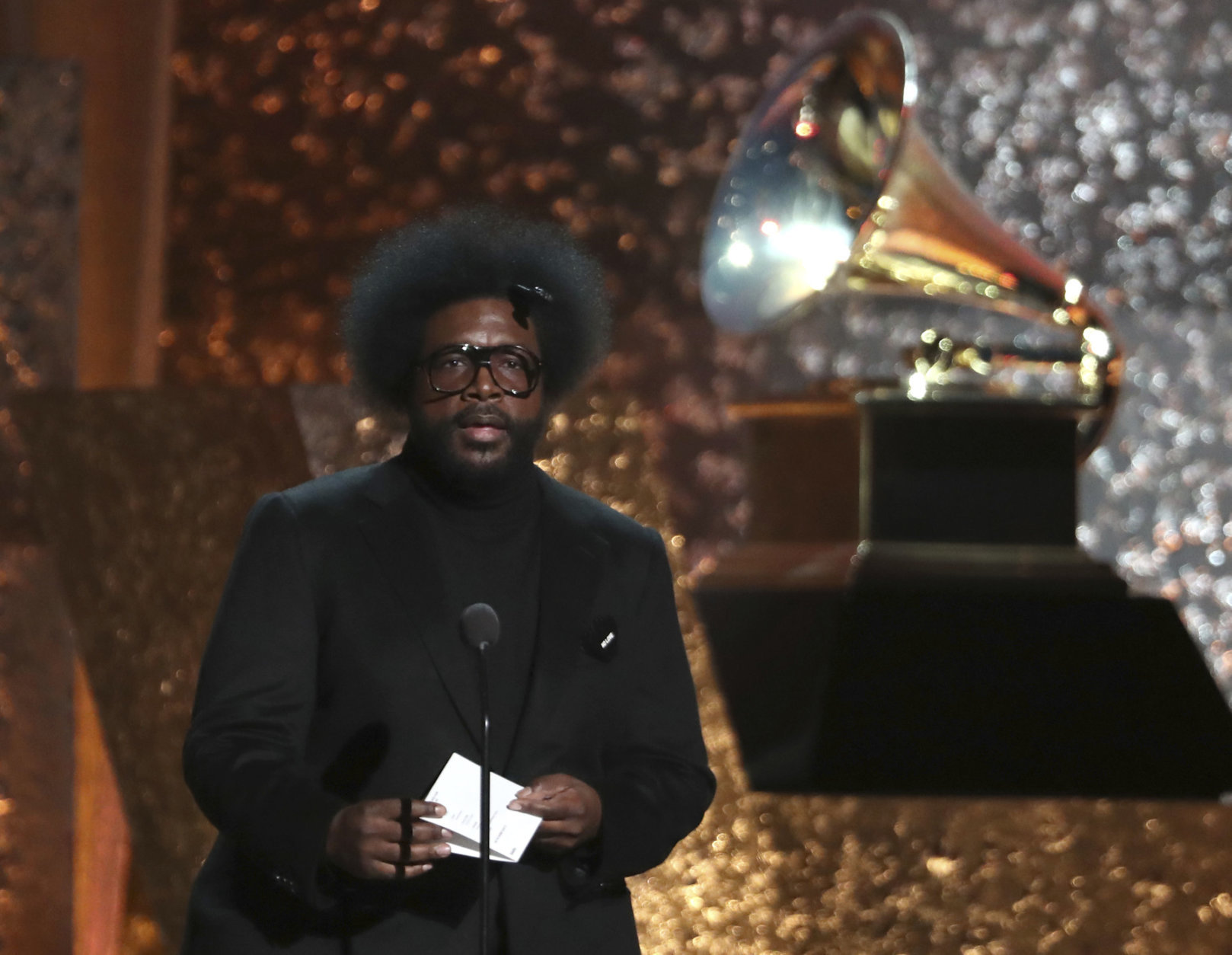 Questlove presents an award at the 61st annual Grammy Awards on Sunday, Feb. 10, 2019, in Los Angeles. (Photo by Matt Sayles/Invision/AP)