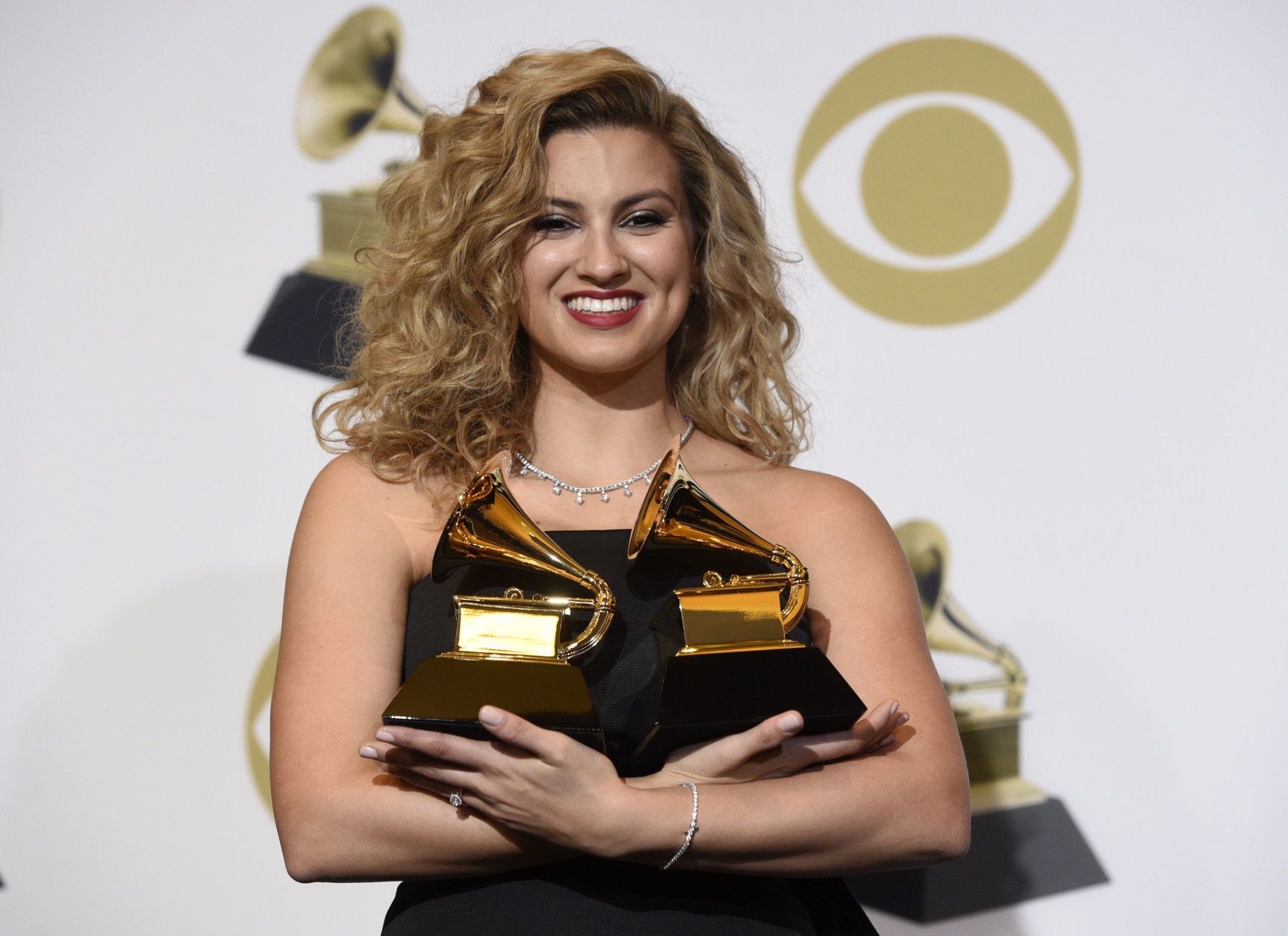 """Tori Kelly poses in the press room with the awards for best gospel performance/song for """"Never Alone"""" and best gospel album for """"Hiding Place"""" at the 61st annual Grammy Awards at the Staples Center on Sunday, Feb. 10, 2019, in Los Angeles. (Photo by Chris Pizzello/Invision/AP)"""