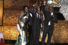 """Soweto Gospel Choir accept the award for best world music album for """"Freedom"""" at the 61st annual Grammy Awards on Sunday, Feb. 10, 2019, in Los Angeles. (Photo by Matt Sayles/Invision/AP)"""