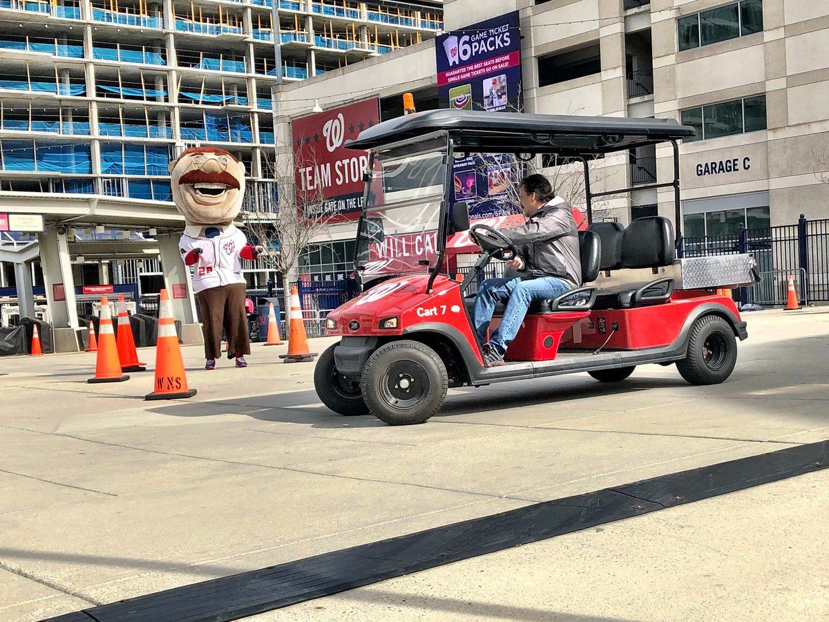 Would-be bullpen cart drivers audition in center field plaza at Nationals Park. (WTOP/Neal Augenstein)