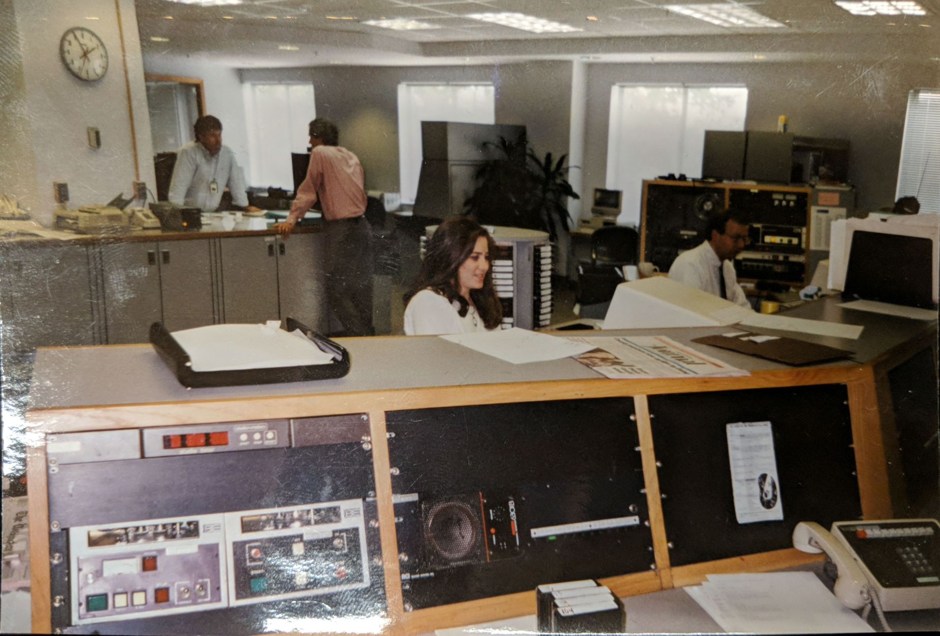Former news and programming director Michelle Komes-Dolge (center) and Mike McMearty (right), who currently holds the title, work at the editor's desk back before renovations at 3400. (Courtesy Mike McMearty)