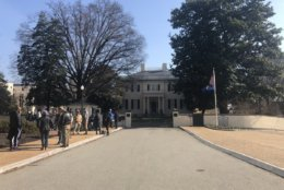 Media and protesters are outside the Executive Mansion in Richmond waiting for Gov. Ralph Northam to speak about a racist photo in his medical school yearbook. (WTOP/Melissa Howell)