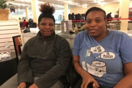 Melissa Dawson of Bowie (left) and 14-year-old Aaien Thompson attending Saturday's event. Aaien says he hopes to land a summer job to make some money. He's interested in jobs that involve answering phones. He also tells WTOP he likes to draw. (WTOP/Liz Anderson)