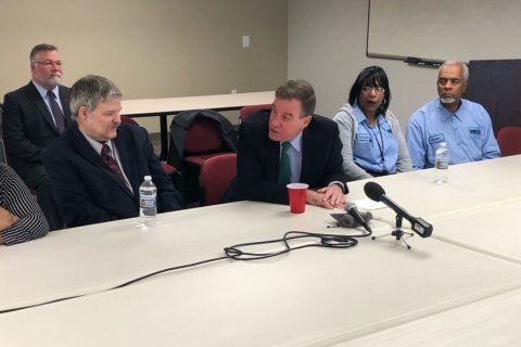 'It's un-American' — Va. Sen. Warner seeks back pay for contractors