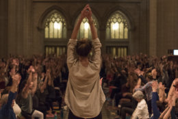 """Yogis strike a pose Wednesday night at the Washington National Cathedral. About 1,200 showed up for the sold-out yoga-and-meditation night, which is part of the week's """"Seeing Deeper"""" events. (Courtesy Washington National Cathedral/Danielle E.Thomas)"""