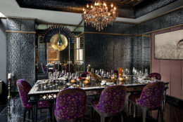 "The restaurant's pièce de résistance is its private dining room dubbed the ""sheesh mahal,"" or palace of mirrors, which is decorated with 150,000 convex mirrors. Hermès plates set the 10-seat table.  (Courtesy Punjab Grill/Jennifer Hughes)"