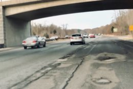 Tires slam up and down as you navigate around huge potholes, and you need to slow down significantly to avoid damaging your vehicle. (WTOP/Nick Iannelli)