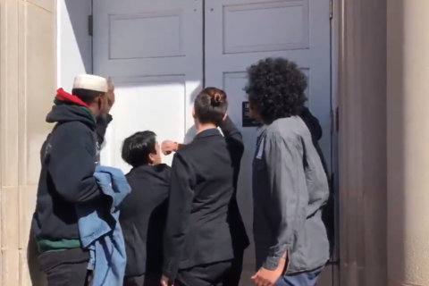 Chanting students ejected from meeting on private police for Johns Hopkins University