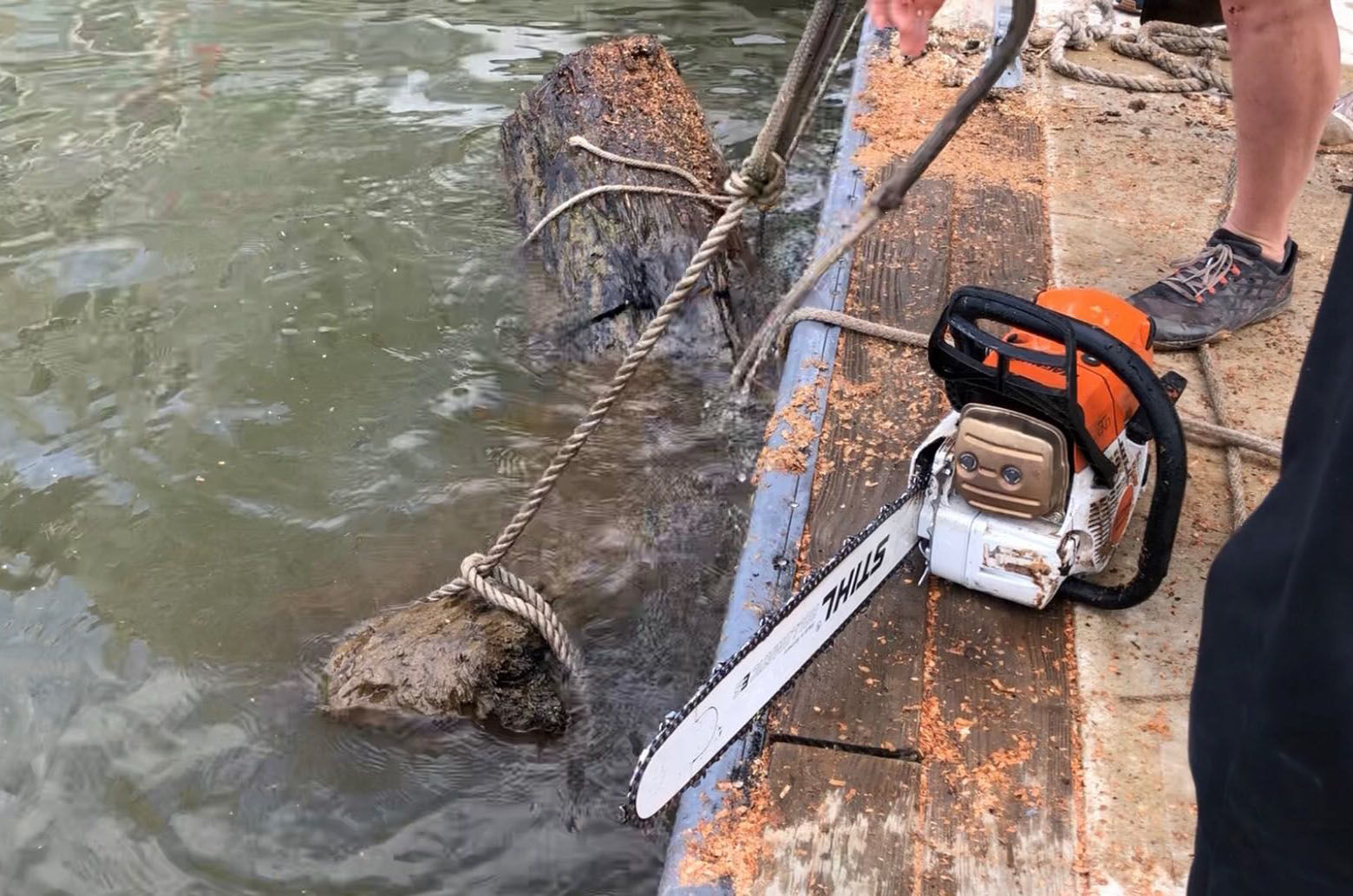 Who knew chain saws can be used partially submerged in water? (WTOP/Kristi King)