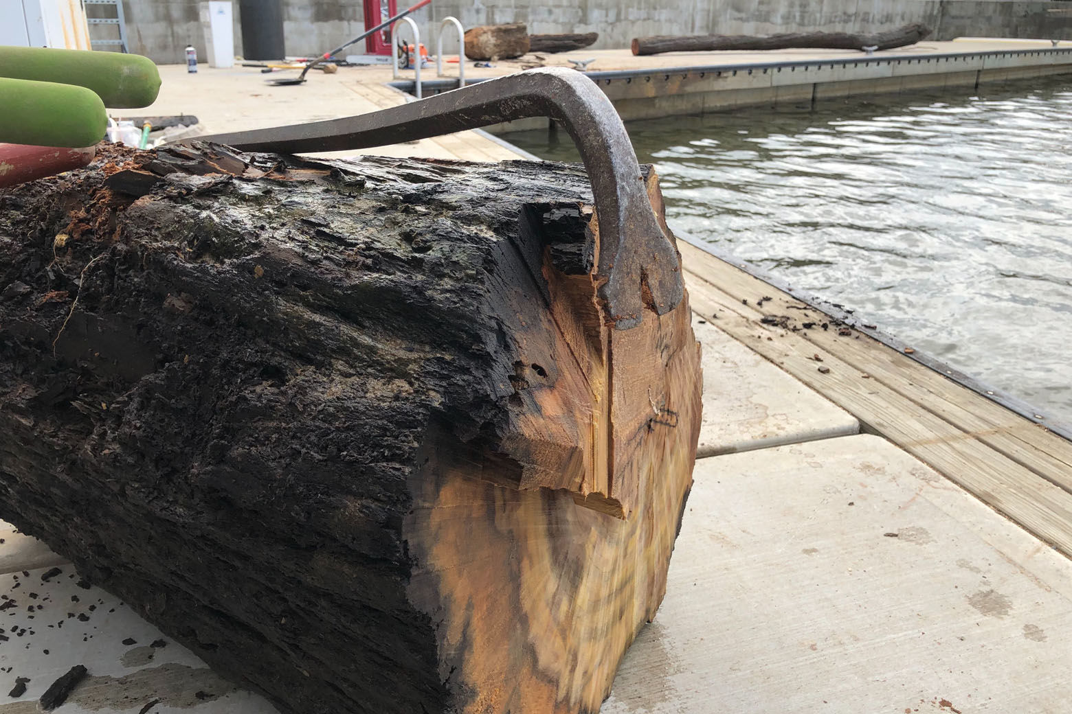 Multiple tools are need to break up wood into pieces in manageable enough sizes to be lifted from the water.(WTOP/Krist King)