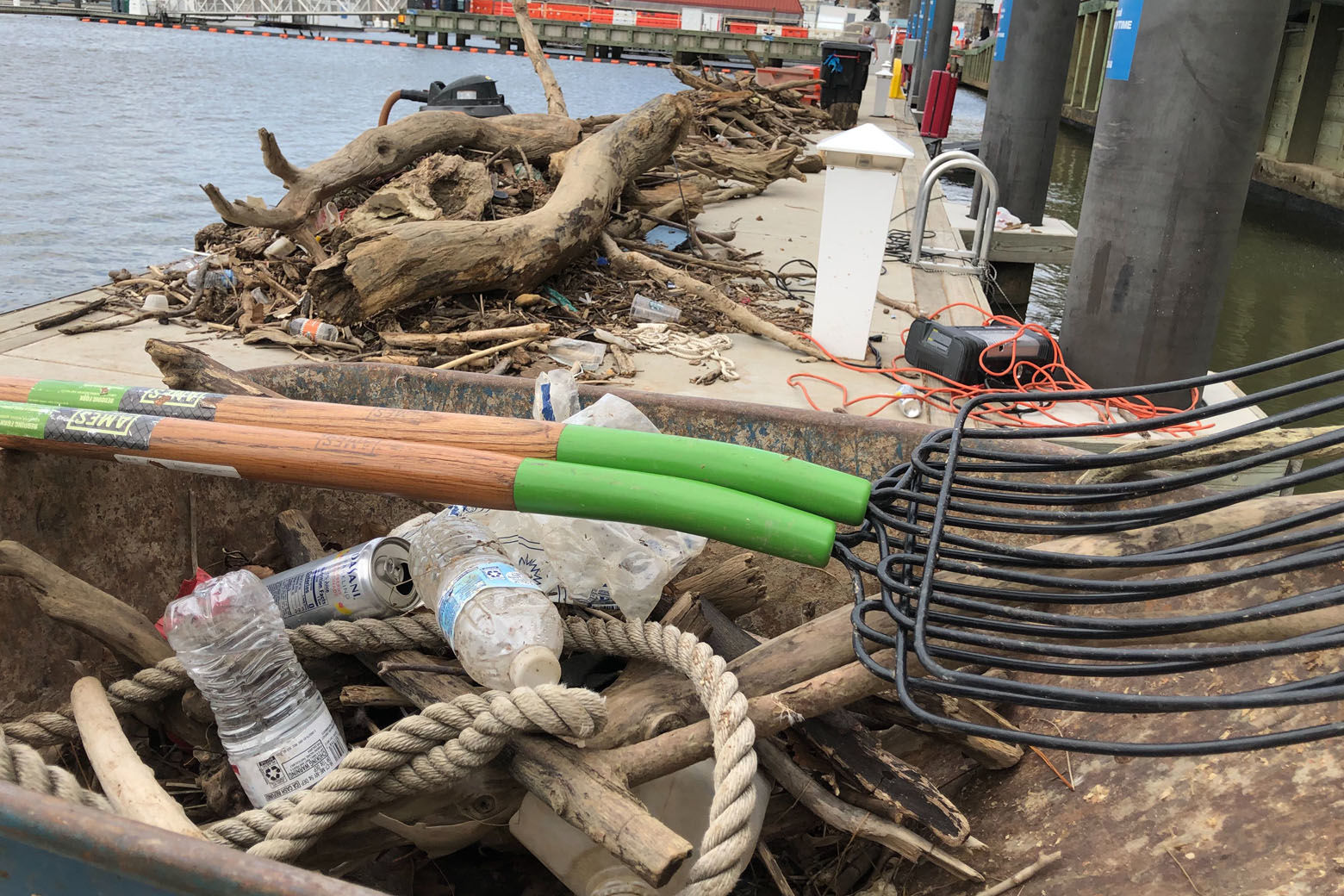 An ongoing team of volunteers, organizations and The Wharf working to clean up the channel along the Southwest waterfront in D.C. has removed enough wood and debris to fill four 30-yard dumpsters. (WTOP/Kristi King)