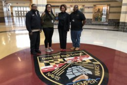 Pictured with staff, Oxon Hill High School Principal Mar-c Holland, second from right, said driver safety will continue to be part of the curriculum.  (WTOP/Kristi King)