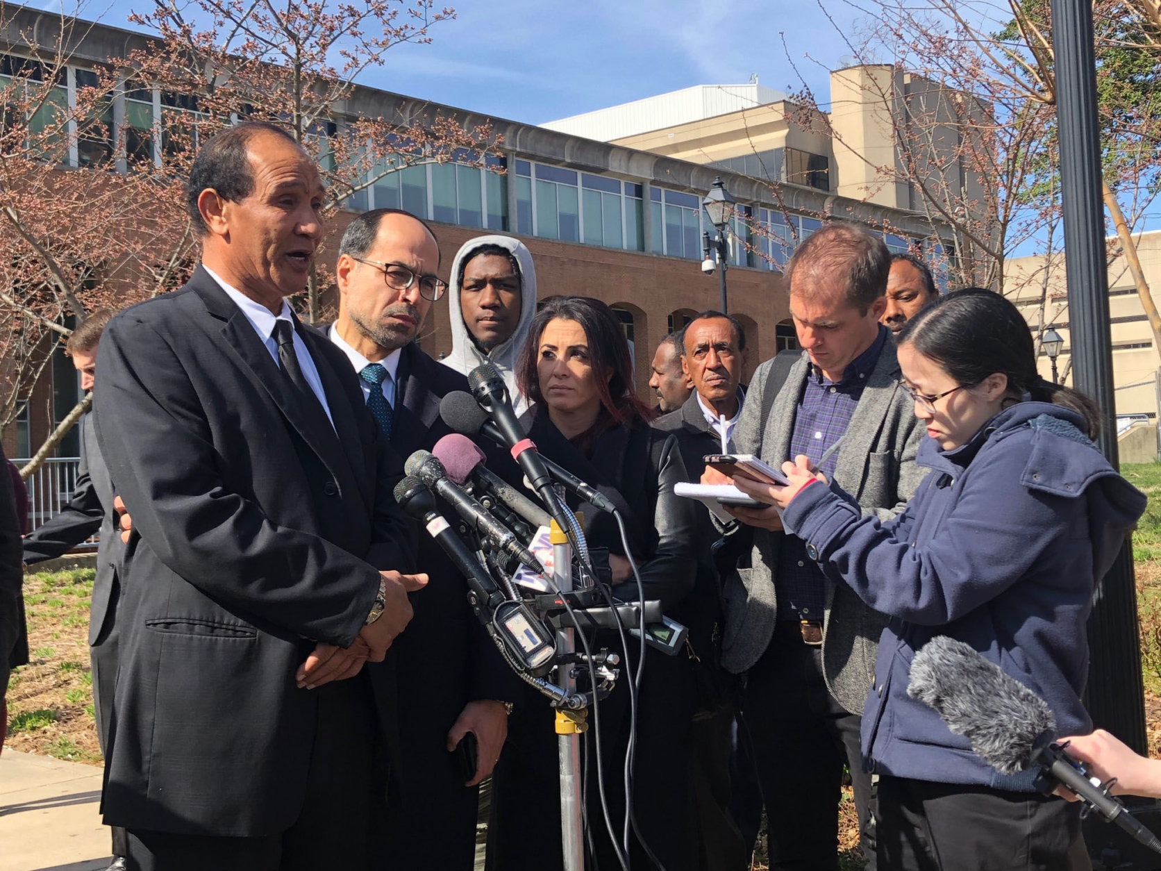Nabra Hassanen's father, Mohmod Hassanen, gives a statement outside the Fairfax County Courthouse after Darwin Martinez-Torres was sentenced to life in prison without parole in the killing and rape of his daughter. (WTOP/Megan Cloherty)