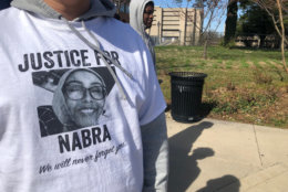 """A person with a """"Justice for Nabra"""" T-shirt ouside the Fairfax County Courthouse. (WTOP/Megan Cloherty)"""