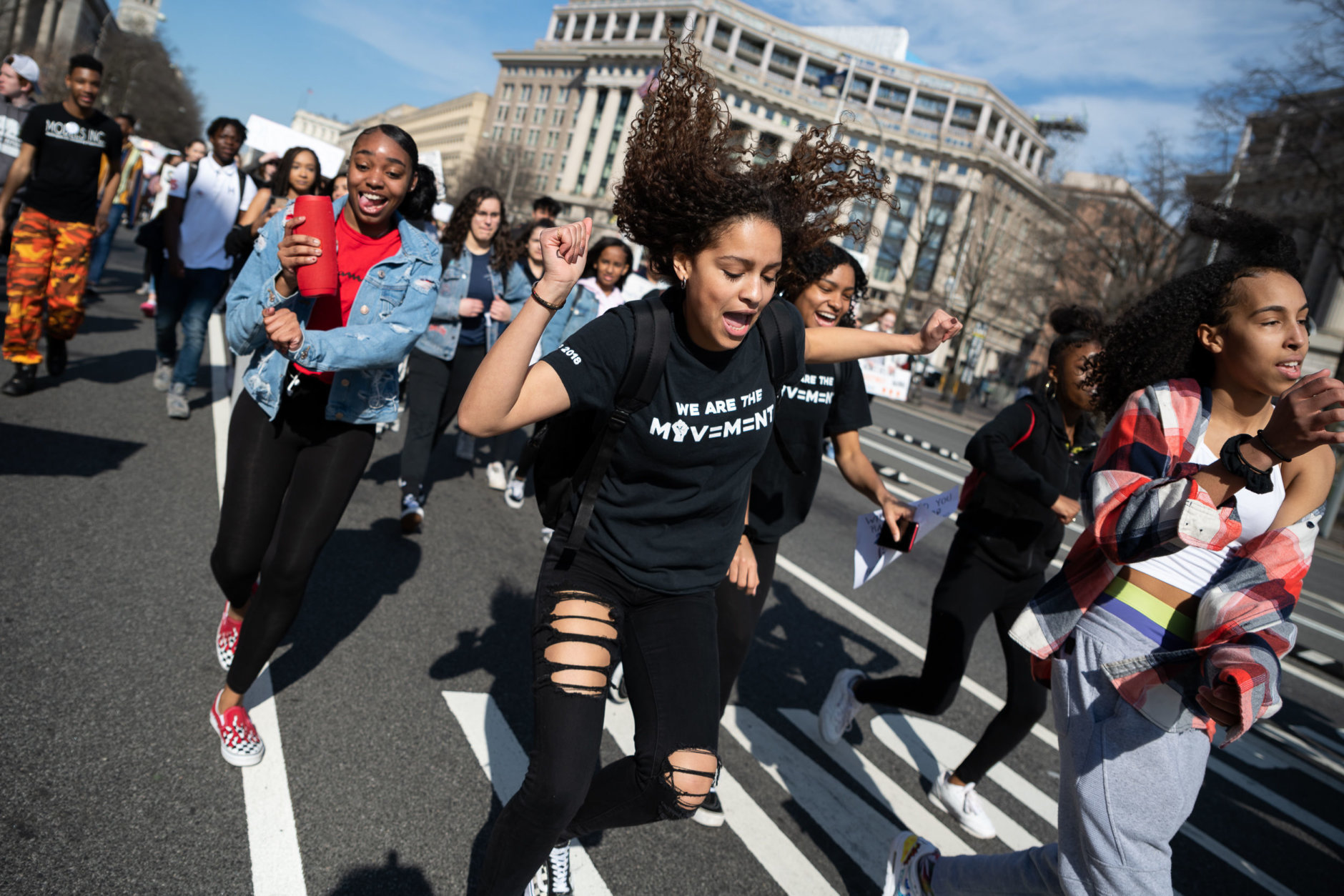 Students dance in the middle of Pennsylvania Avenue during a march to the Capitol building. (WTOP/Alejandro Alvarez)