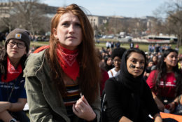 A student listens to members of Congress address the walkout outside the U.S. Capitol. (WTOP/Alejandro Alvarez