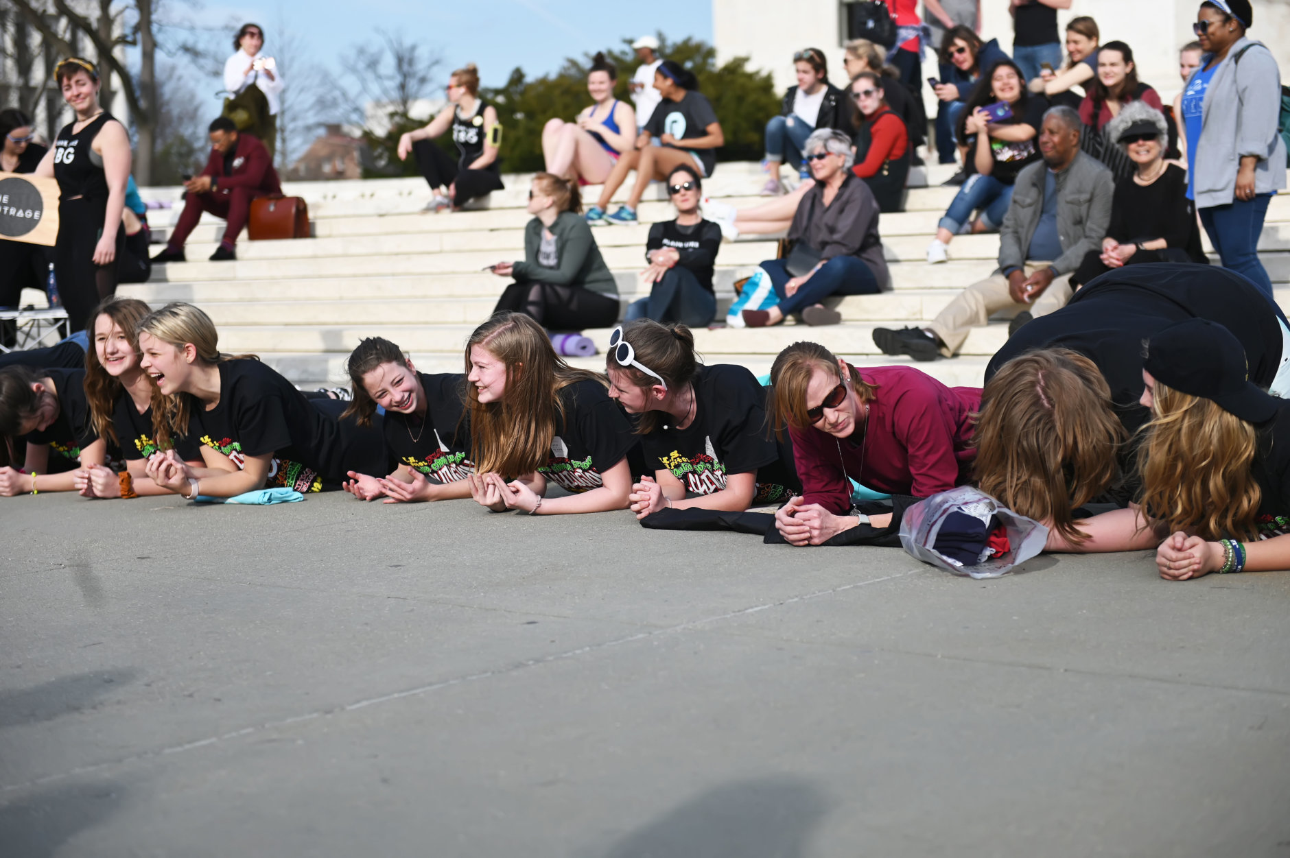 A group of tourists walking by the Supreme Court join in on the birthday celebration for Justice Ginsburg A perfect side plank in honor of Justice Ginsburg. (Courtesy Shannon Finney)