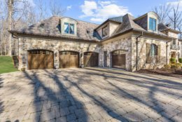 The home features a four-car garage. (Courtesy Washington Fine Properties)