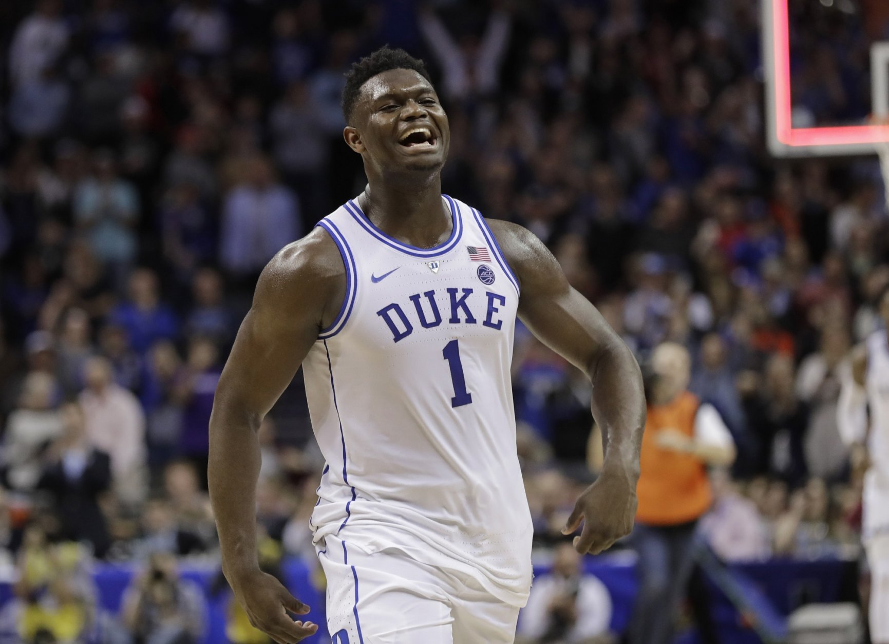 Duke's Zion Williamson (1) celebrates after Duke defeated Florida State in the NCAA college basketball championship game of the Atlantic Coast Conference tournament in Charlotte, N.C., Saturday, March 16, 2019. (AP Photo/Nell Redmond)