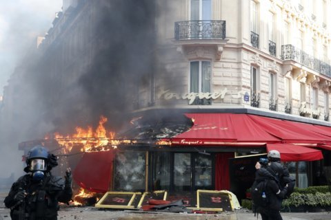 Paris cleans up riot debris as support fades for protesters